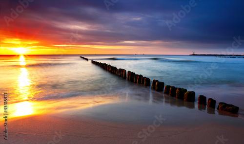 Obraz Baltic sea at beautiful sunrise in Poland beach.