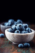 Bilberries in a small stone bowl