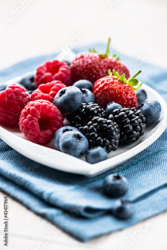 Various berry fruits on a plate
