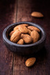 Almonds in a small stone bowl