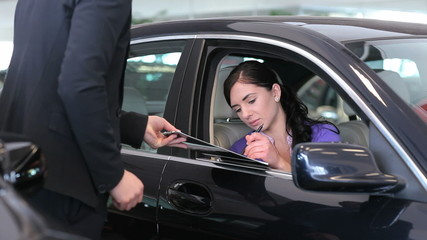 Woman signing on a notepad