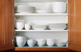 New White Dishes and Bowls in Kitchen Cabinet