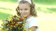 Closeup portrait of a girl with flowers looking