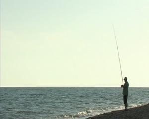 Fisherman fishing in the shore 16_9