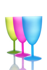 Bright plastic goblets isolated on white