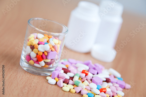 Colourful medicines on wood background