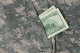 Dollars in uniform pocket