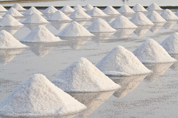Salt fields with piled up sea salt in Thailand