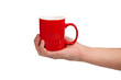 Male hand is holding a red cup