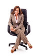 Full body portrait of young business woman sitting on the chair