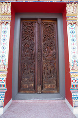 Carved doors in temple at Thailand.