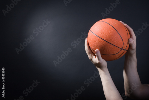 Poster Player plays with a basketball