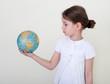 Globe on child hands