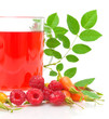 rosehip berries, raspberries and a cup of tea on a white backgro