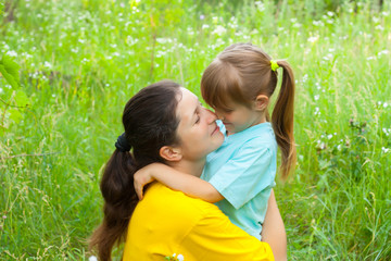Smiling young mother has  good time with daughter