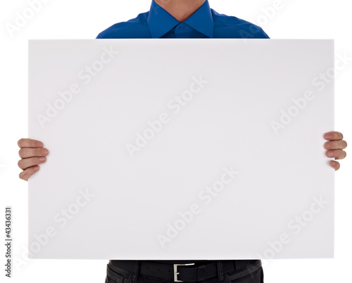 man in shirt holding blank sign