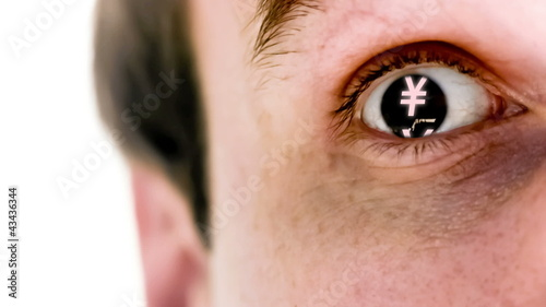 Man with yen symbol in his eye in slow motion
