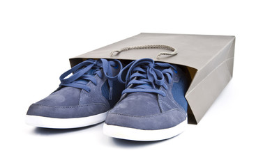 shoes in a paper bag