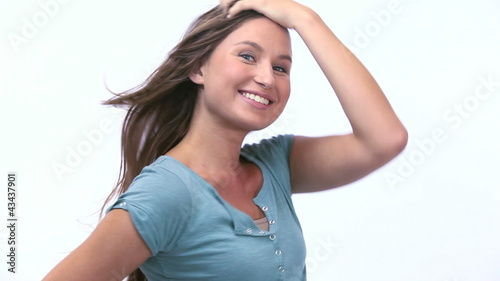 Woman posing against a white background