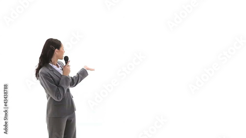 Business woman holding a micro while talking