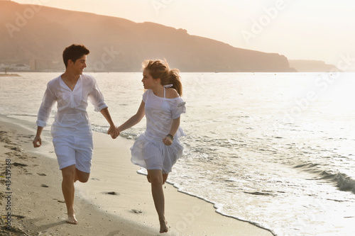 Happy young couple together on the beach
