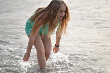 Young happy woman running on beach