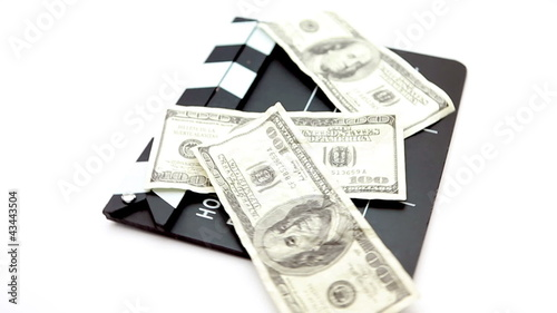 Dollar bills placed on a cinema clap
