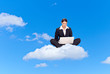 Young business woman with laptop, sitting on a cloud
