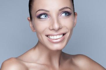 Portrait of happy brunette woman with beautiful eyes
