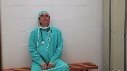 Irritated surgeon sitting on a bench