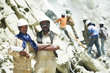 Hindu indian builders workers at construction site