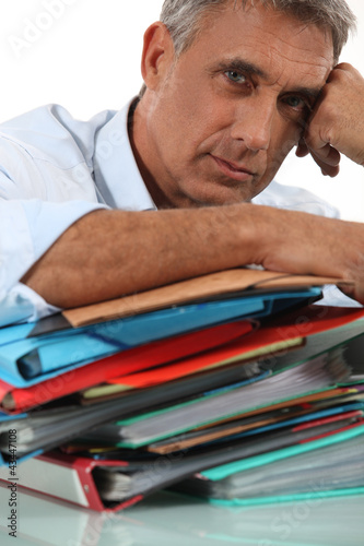 Man with pile of paperwork