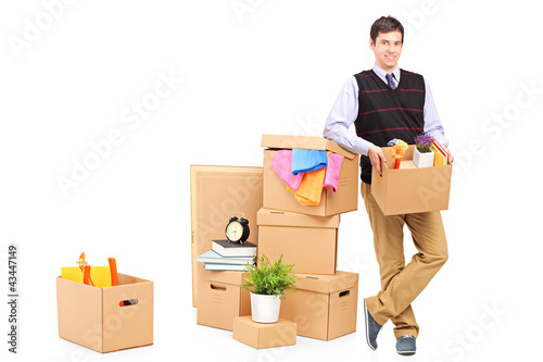 Person with moving boxes and other stuff