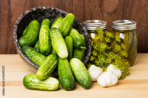 Pickles with jars of pickles
