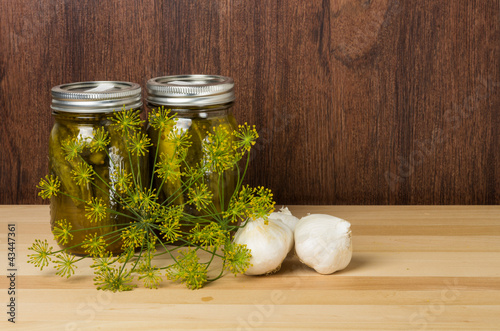 Two jars of pickles with dill