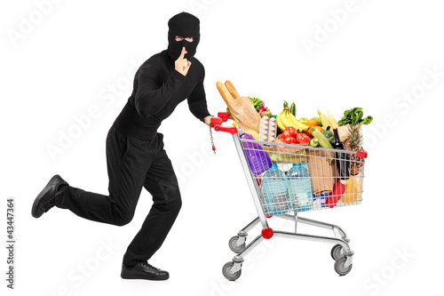 Robber stealing a pushcart with products