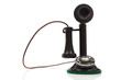 A vintage candlestick phone on a white background
