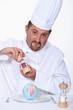 Male chef seasoning globe