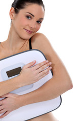 Woman holding bathroom scales