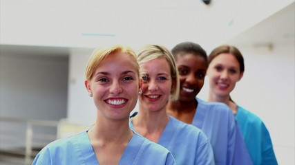 Smiling female nurses looking at camera
