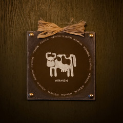 Funny toilet sign with cow