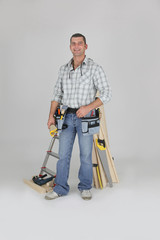 Carpenter posing by his equipment