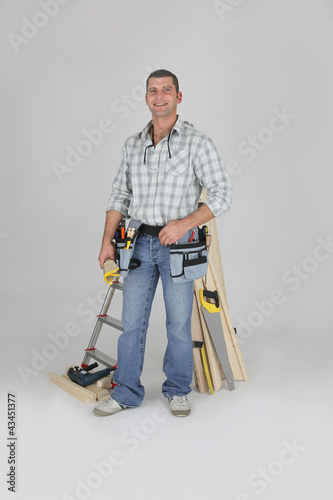 Carpenter posing by his equipment