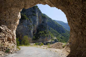 mountain and light through rocky tunnel, Montenegro