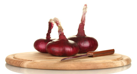 red onion on a cutting board isolated on white background