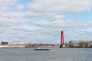 Red suspension bridge over  Maas in Rotterdam. Netherlands