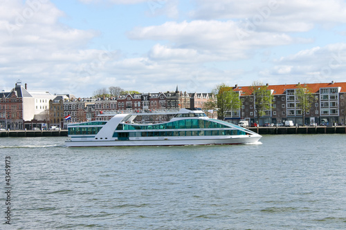 Tourist boat on the river Maas in Rotterdam. Netherlands
