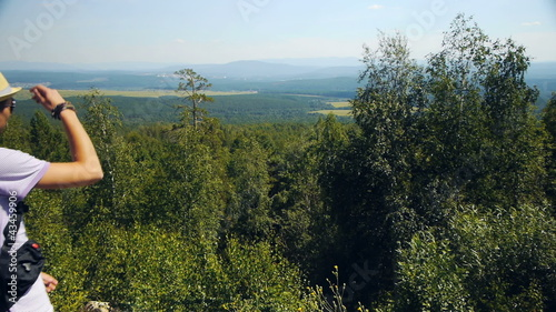 Man standing on the mountain and  looking at summer view