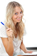 blonde woman holding pen and notepad