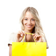 blonde woman holding yellow shopping bag